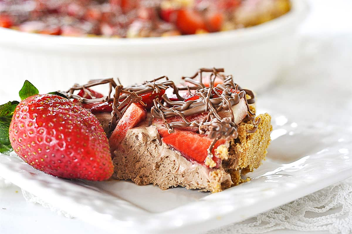 slice of strawberry chocolate pie on a plate