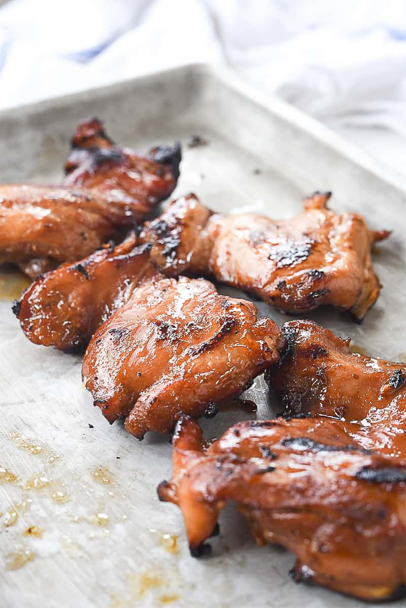 grilled chicken on a baking sheet