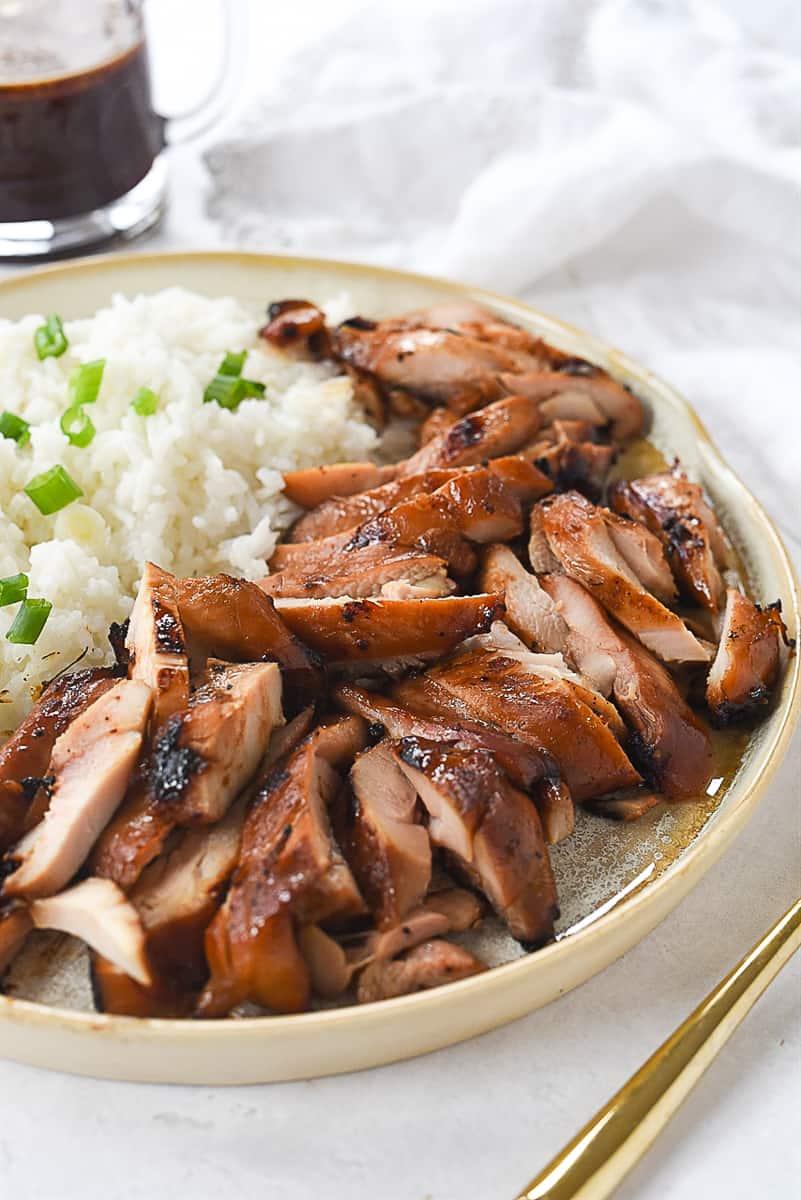 plate of teriyaki chicken and rice
