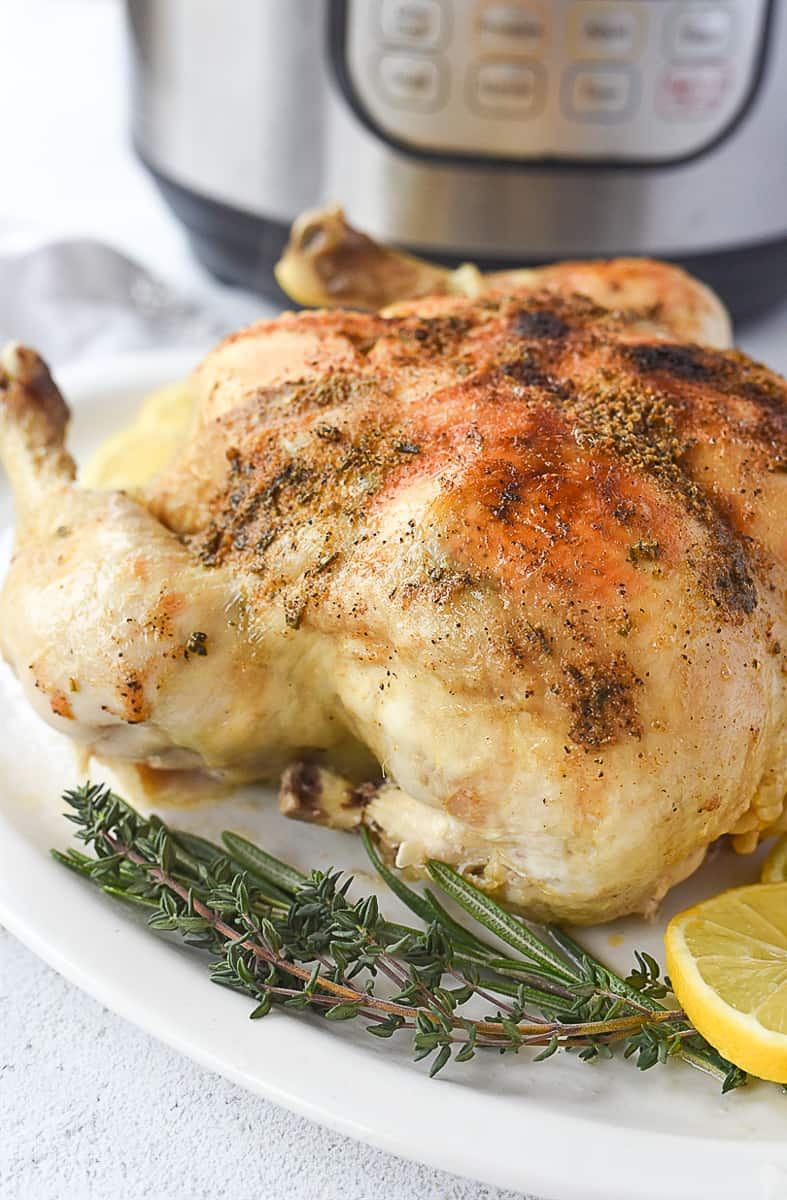 whole chicken in front of an instant pot
