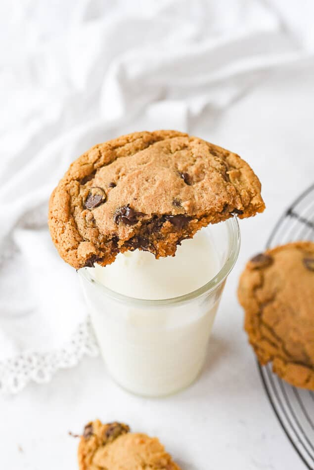 chocolate chip cookie on a class of milk