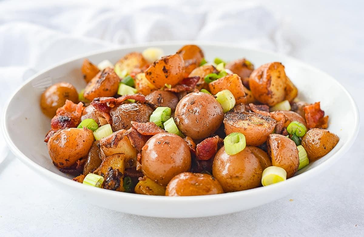 white bowl of breakfast potatoes
