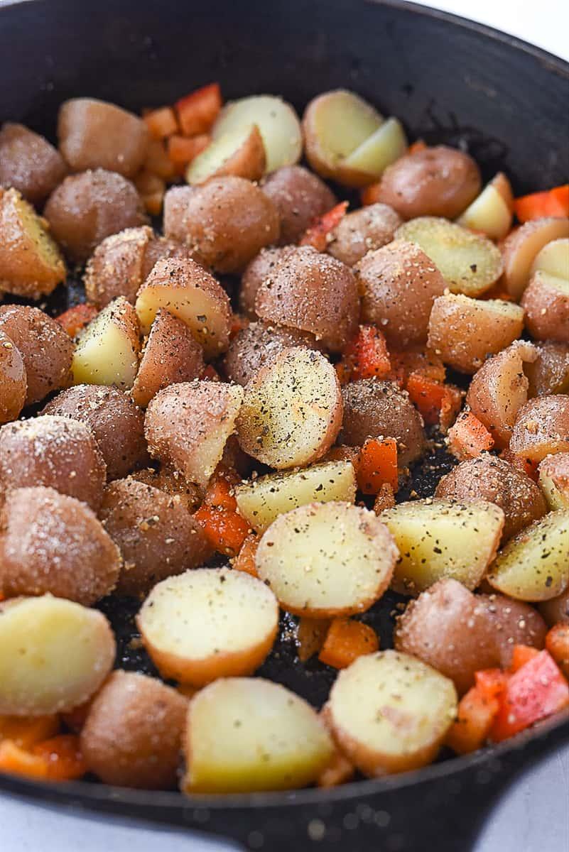breakfast potatoes in a skillet.