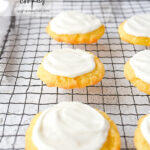 frosted sugar cookies on baking rack