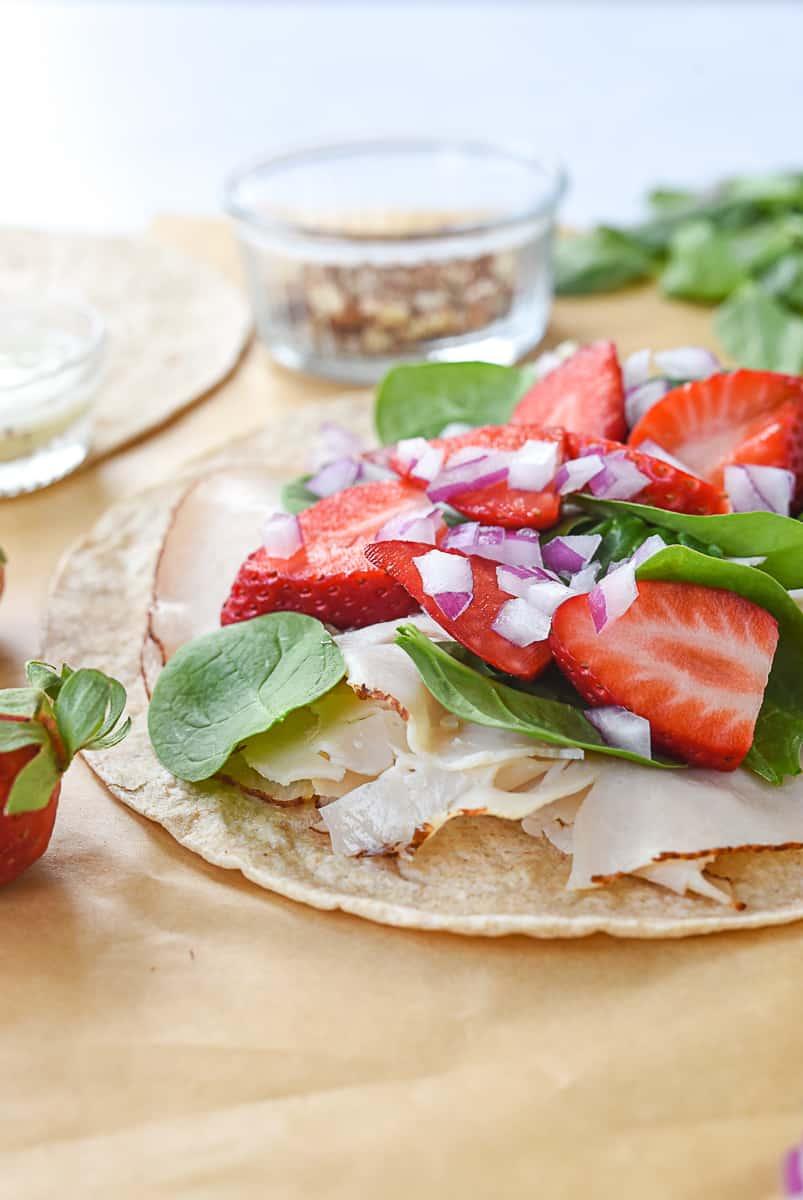 side view of turkey strawberry wrap