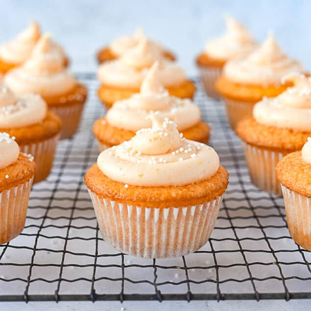 orange cupcakes with frosting