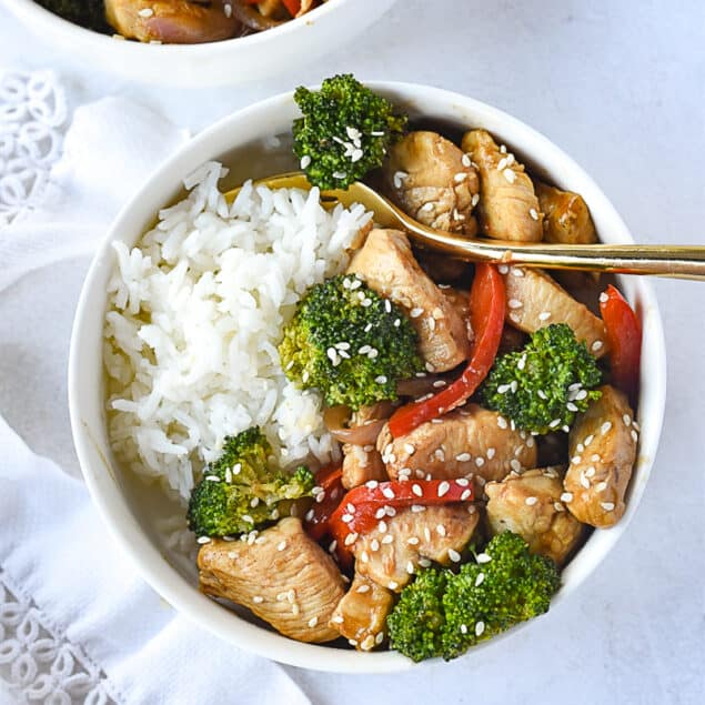 Red Pepper and CHicken Stir Fry in a bowl over rice