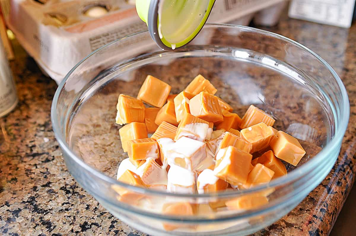 adding milk to caramel
