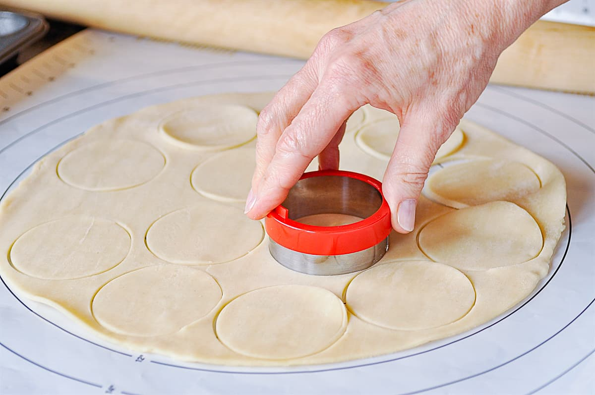 cutting out circles of dough