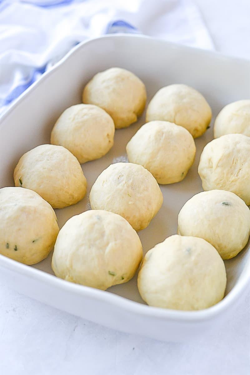 balls of dough in pan