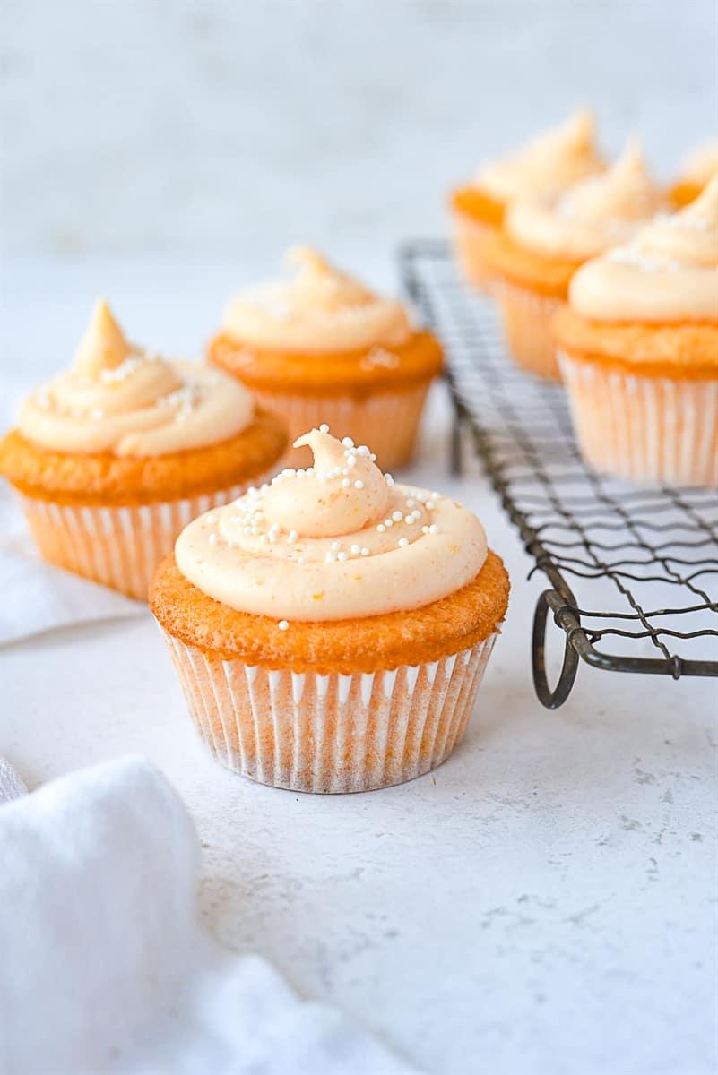 orange cupcakes with orange frosting on top