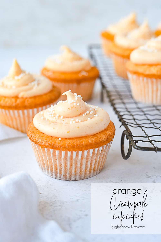 orange creamsicle cupcakes with sprinkles on top