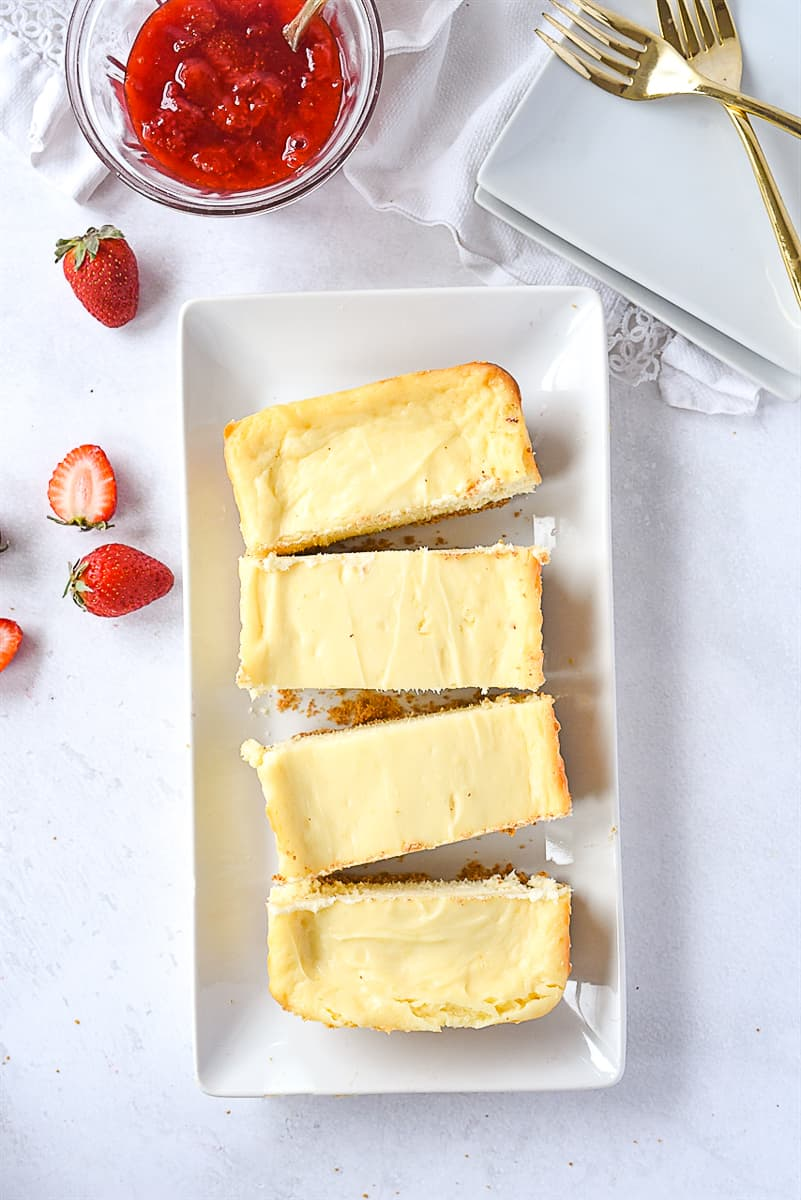 overhead shot of sliced cheesecake for two