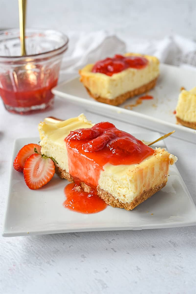 slice of cheesecake with strawberry syrup