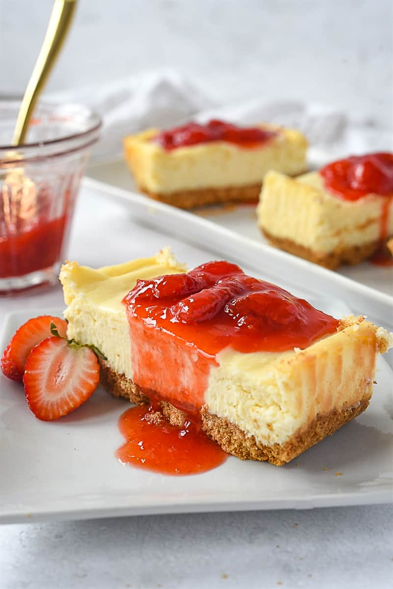 Slice of small batch cheesecake with strawberry sauce