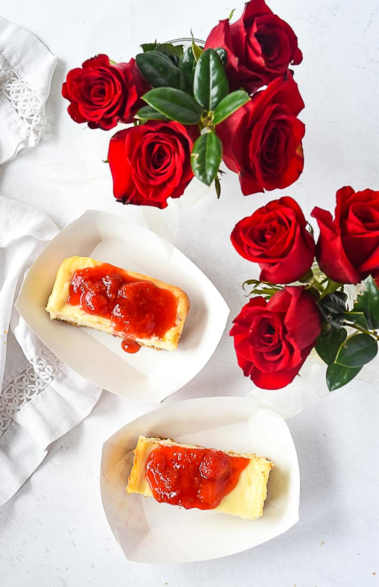 overhead shot of cheesecake and roses