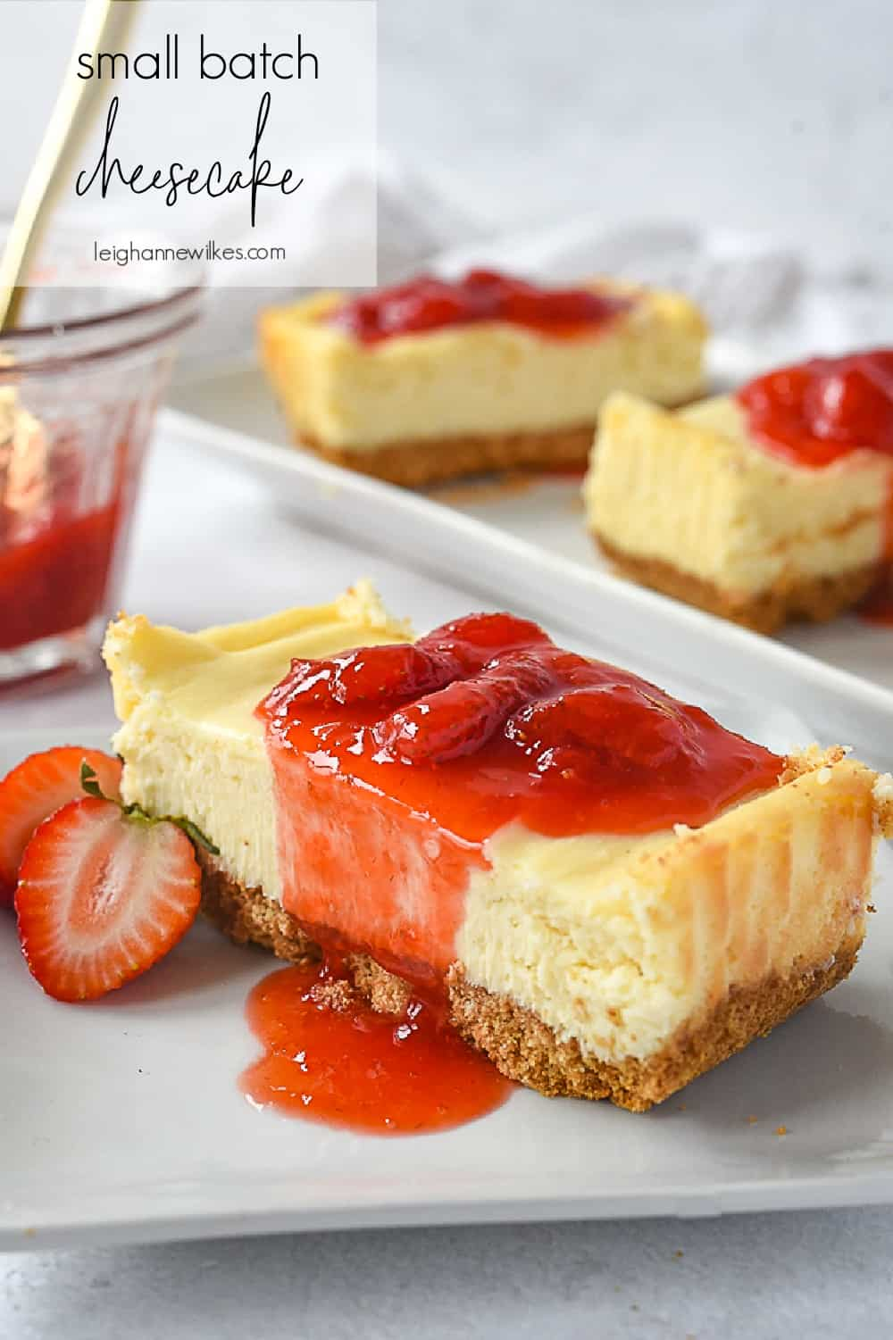 slice of small batch cheesecake with strawberry syrup on top