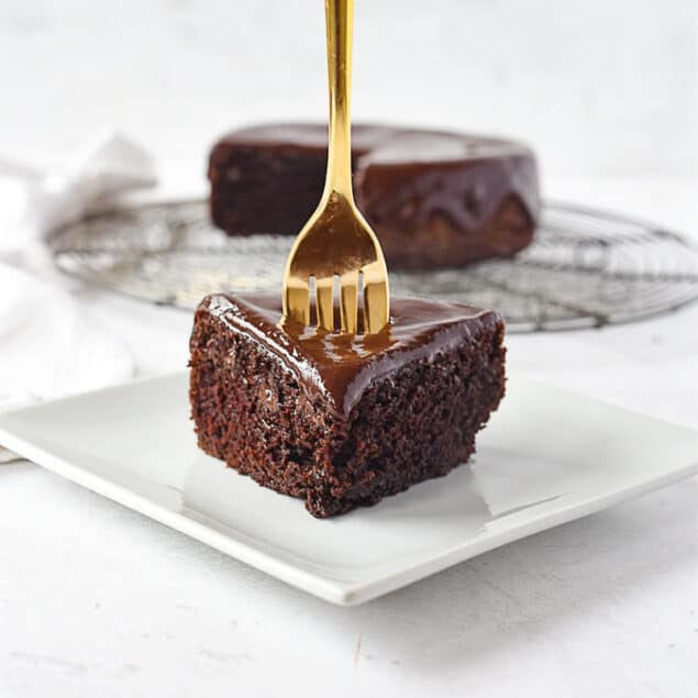 slice of chocolate cake with a fork in it.