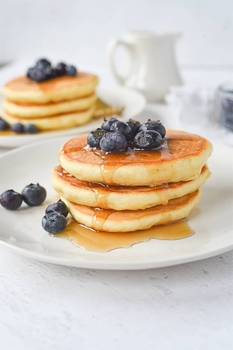 stack of three pancakes with blueberries on top