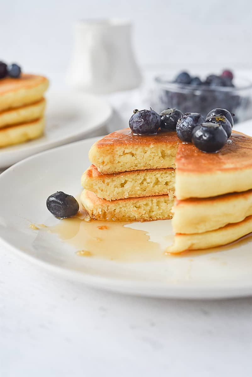 pancakes for two with blueberries on top