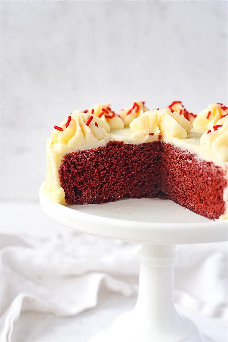 red velvet cake with pieces missing