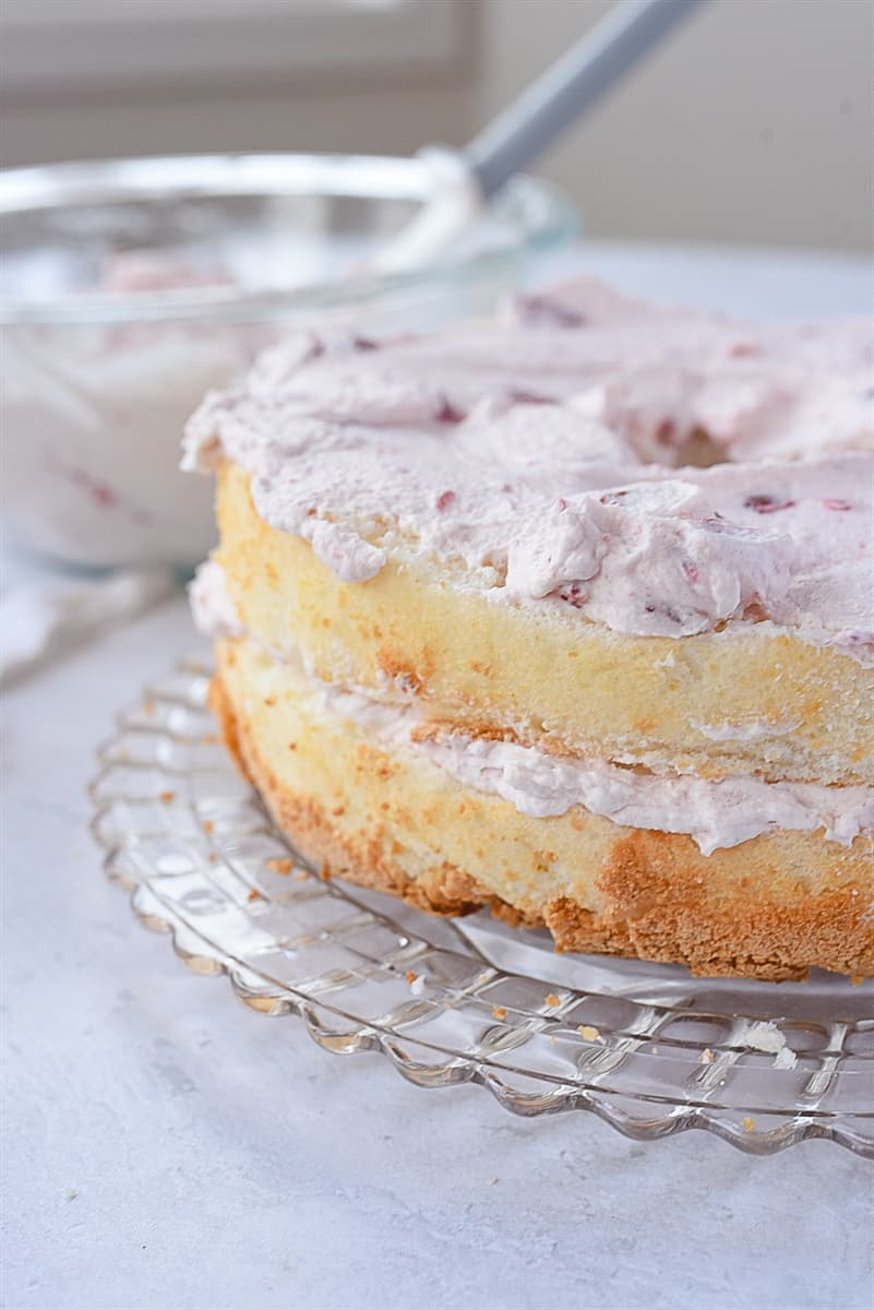layers of angel food cake with cream filling
