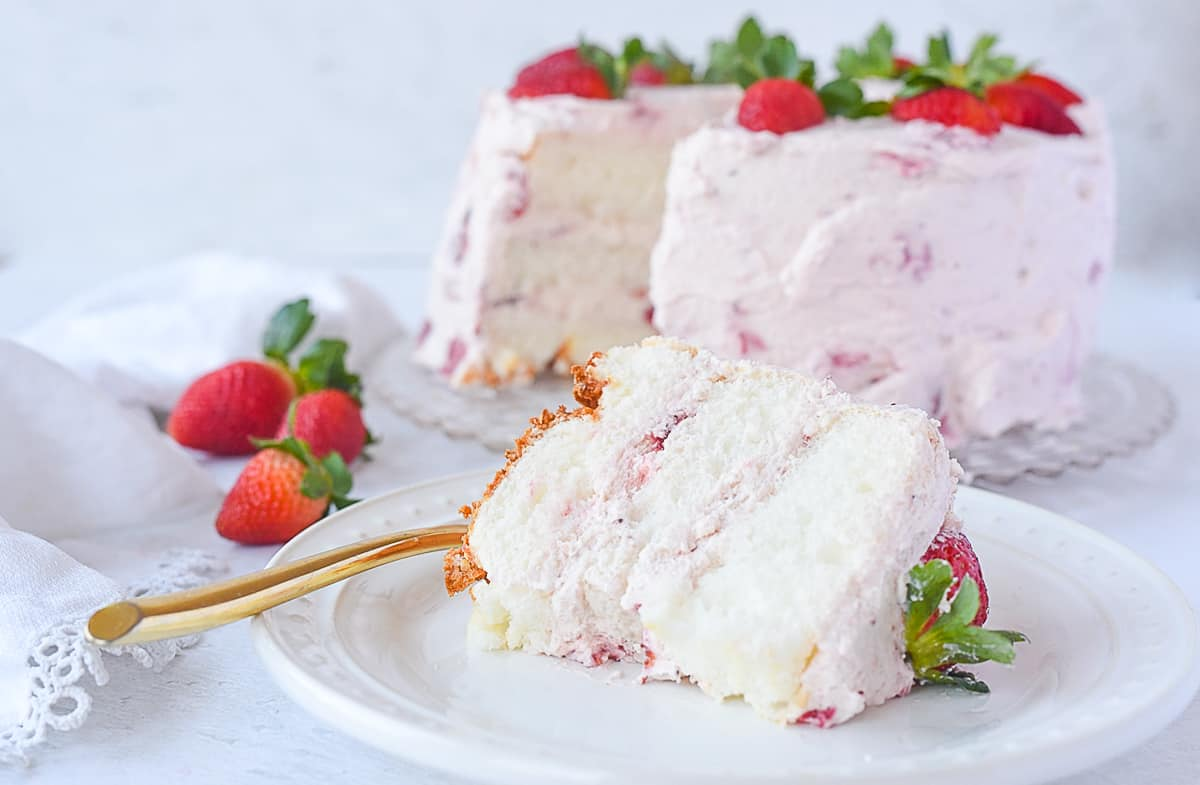 slice of strawberry cream cake on a plate