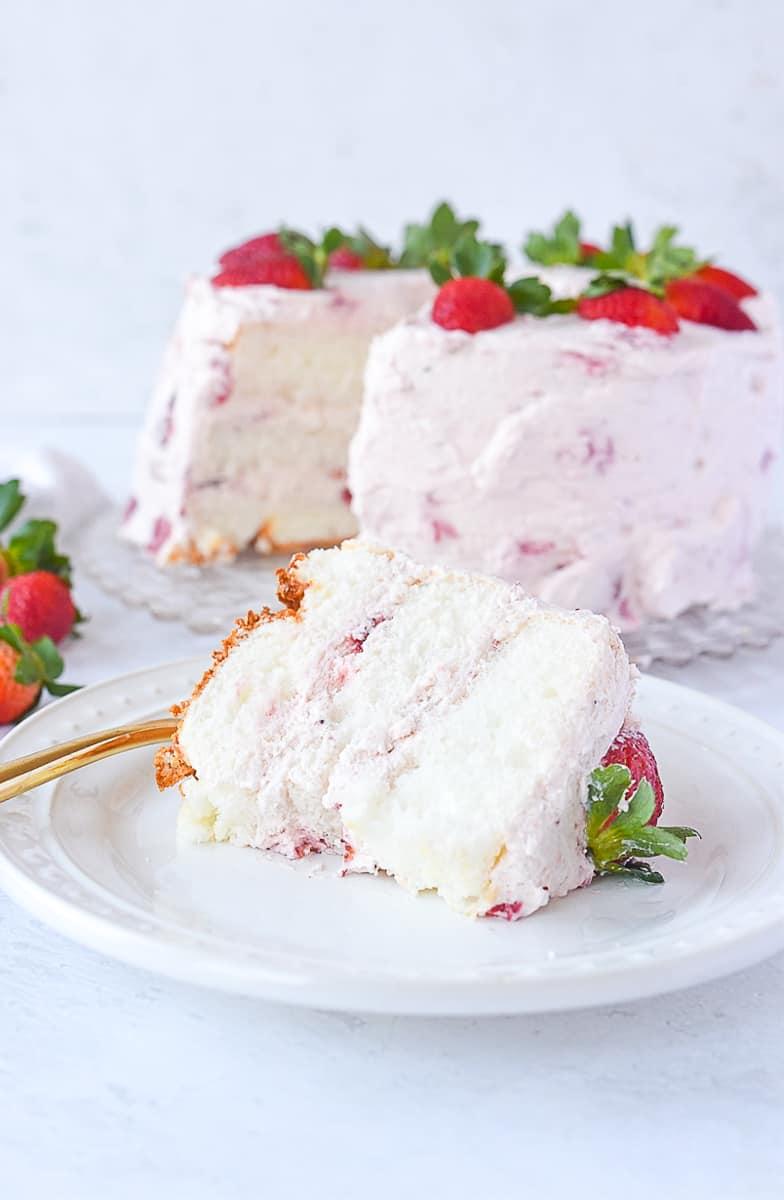 slice of strawberry cream cake on a plate