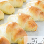 baked crescent rolls on parchment paper