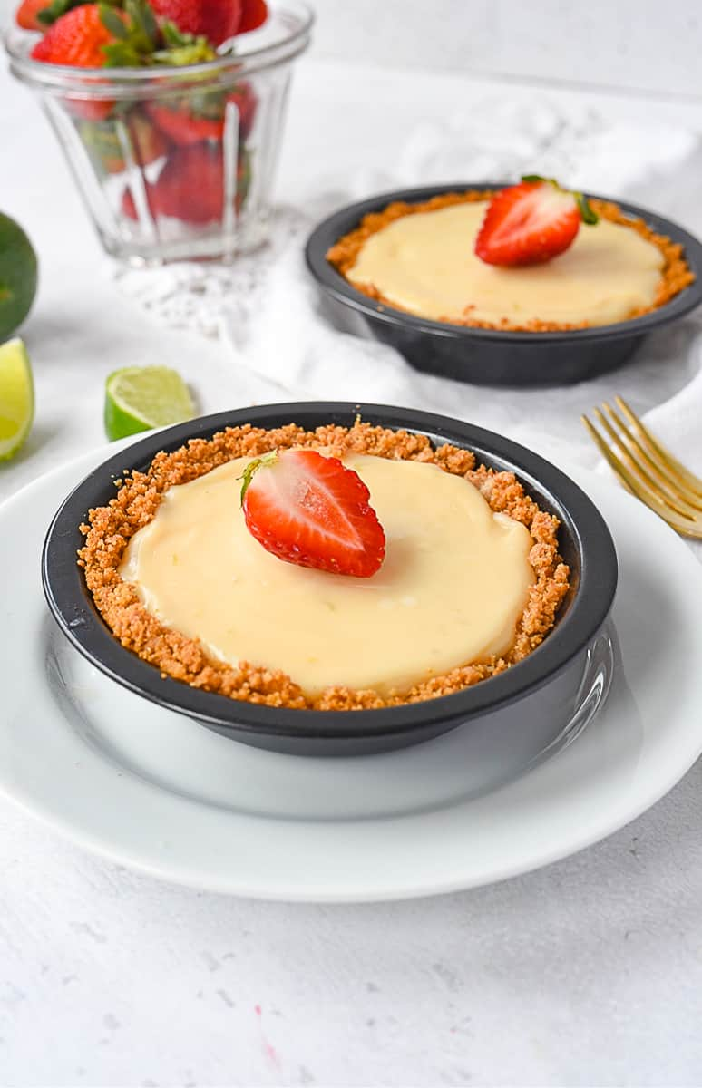 individual key lime pies with strawberries on top