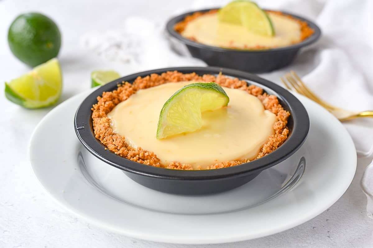two key lime pies on a plate
