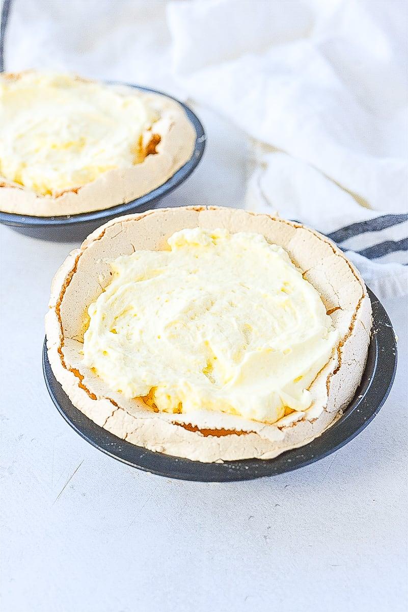 cream mixture in meringue crust