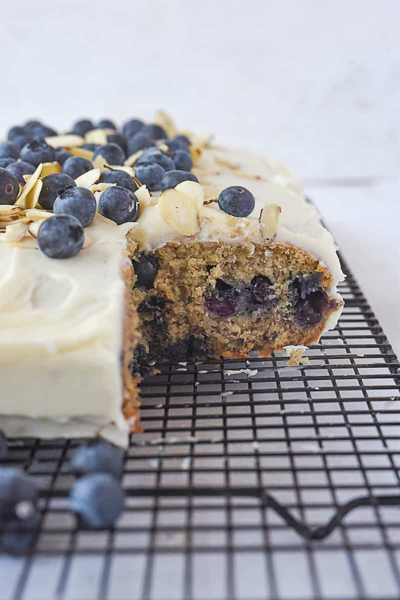 Blueberry banana cake with a piece missing