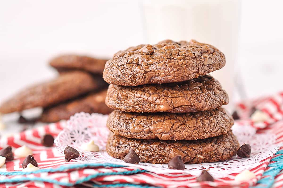 Four triple chocolate cookies in a pile