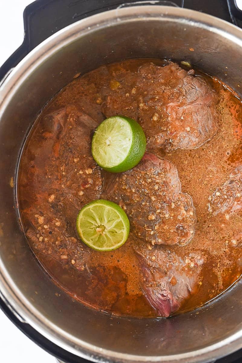 over head shot of beef barbacoa in instant pot