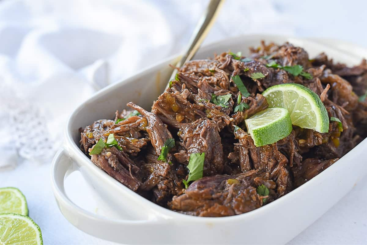 beef barbacoa with cilantro and lime on top