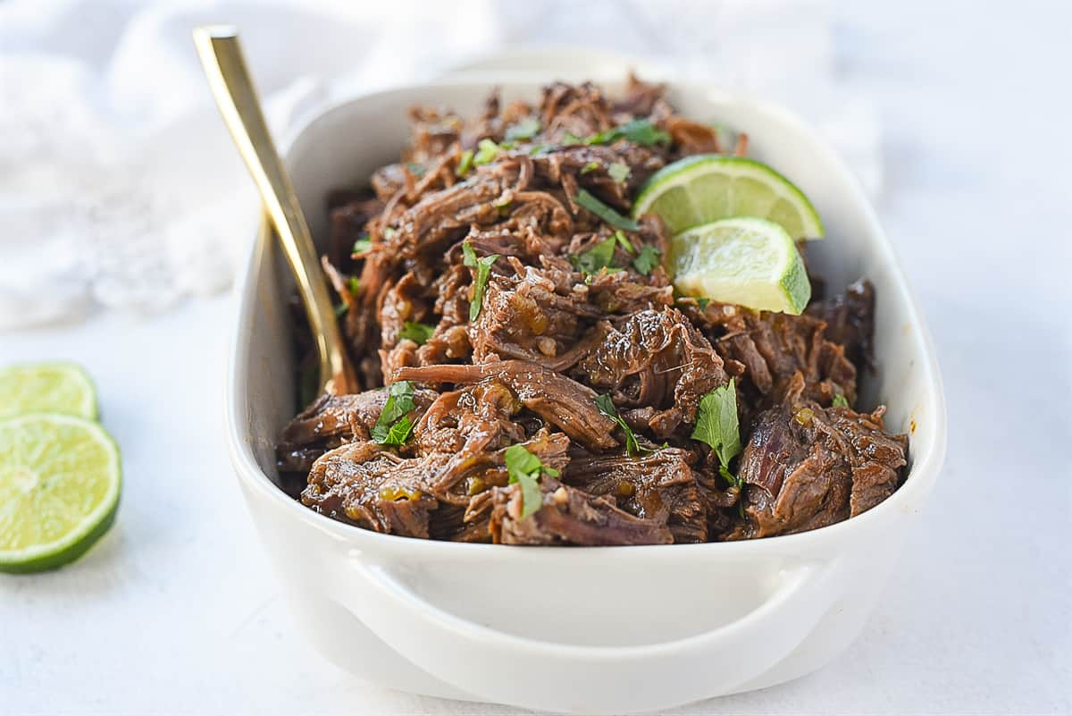 dish of beef barbacoa with a spoon in it
