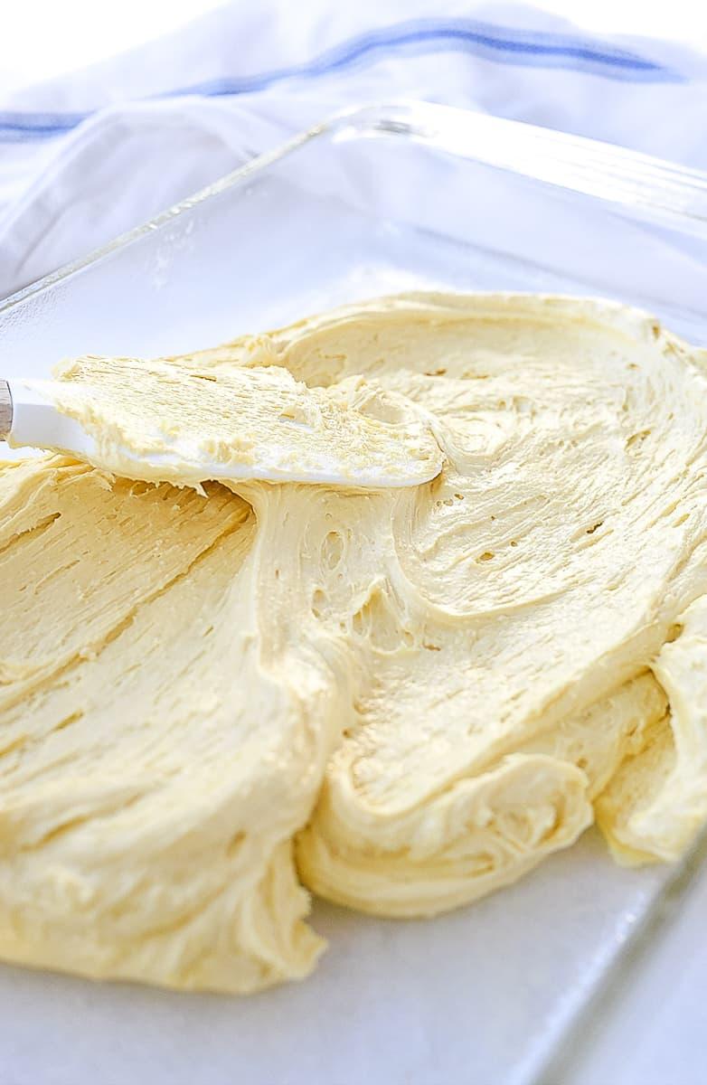 spreading cake batter in pan