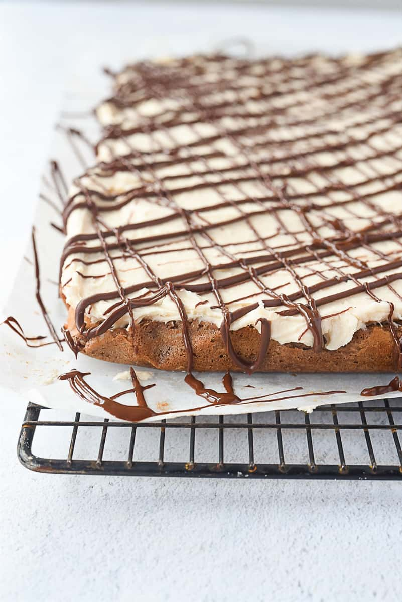chocolate drizzled over brownies