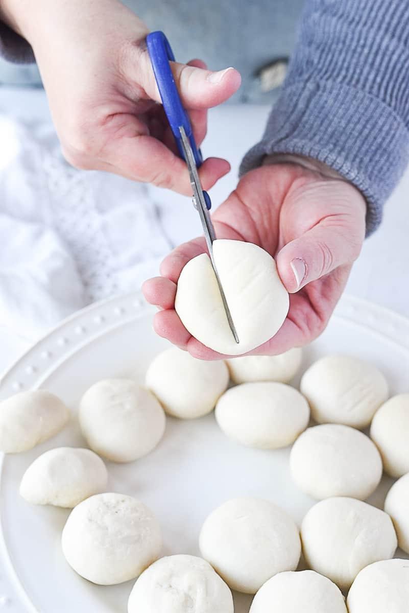cutting roll dough in half