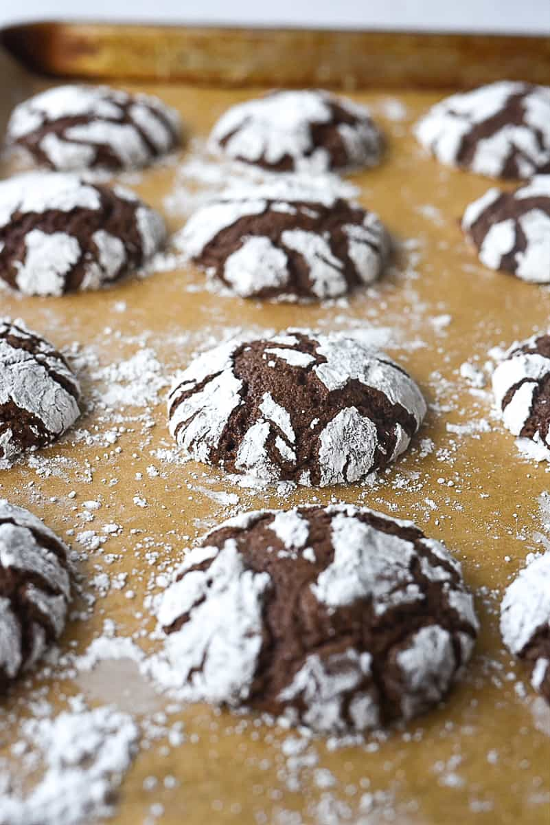 baked chocolate crinkle cookies on a baking sheet