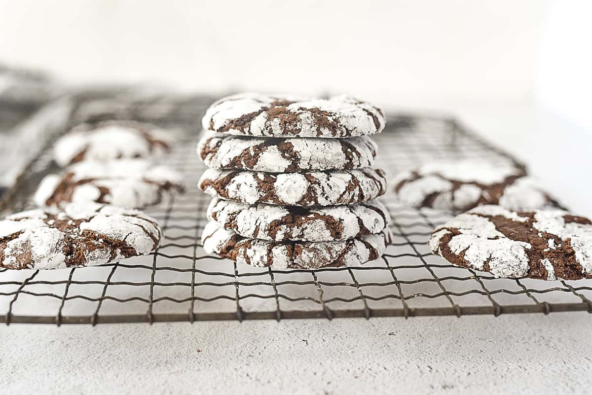 stack of chocolate crinkle cookies on a rack