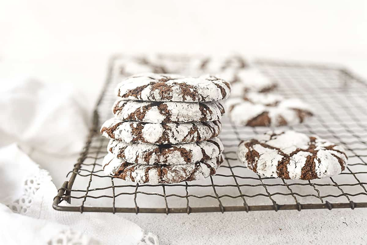 stack of chocolate crinkle cookies on a cooling rack
