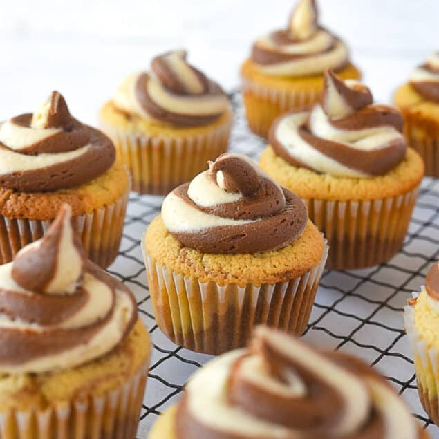 chocolate peanut butter cupcakes on a cooling rack