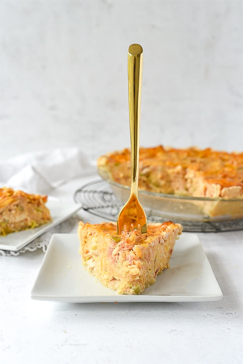 fork in a piece of quiche