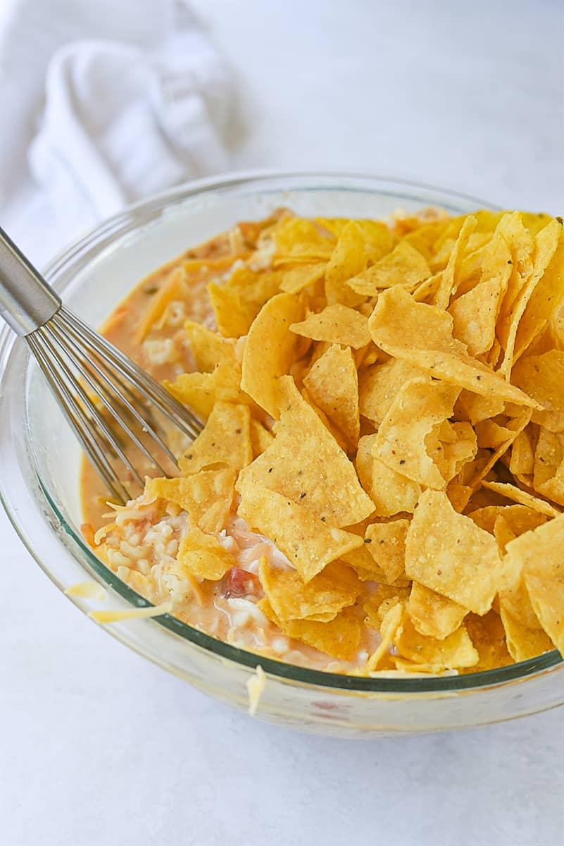 adding chips to quiche mixture