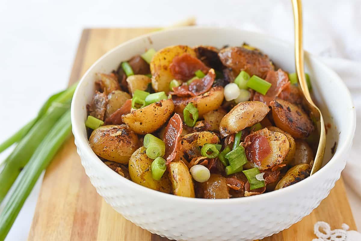 white bowl of potatoes