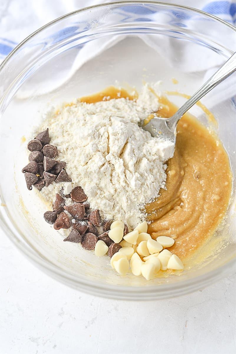 adding flour into cookie dough