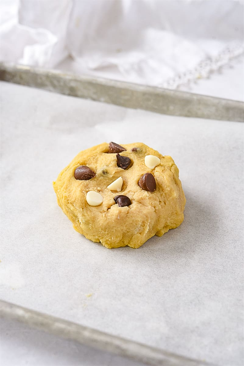 chocolate chip cookie dough on a baking sheet.