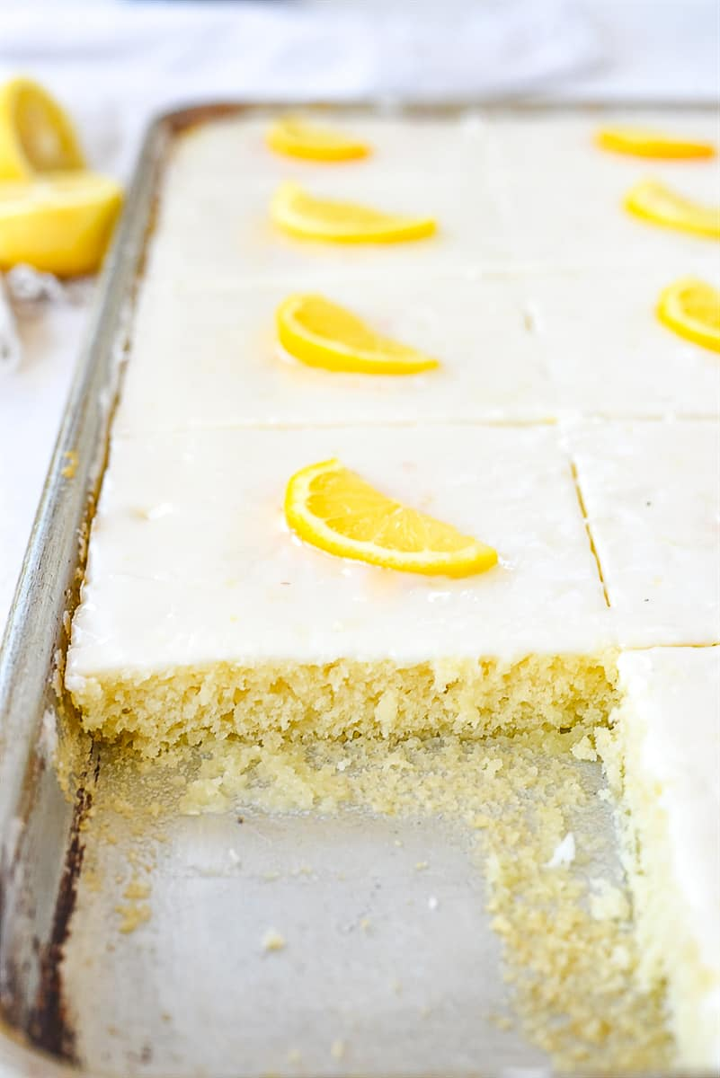 piece of lemon texas sheet cake out of the pan